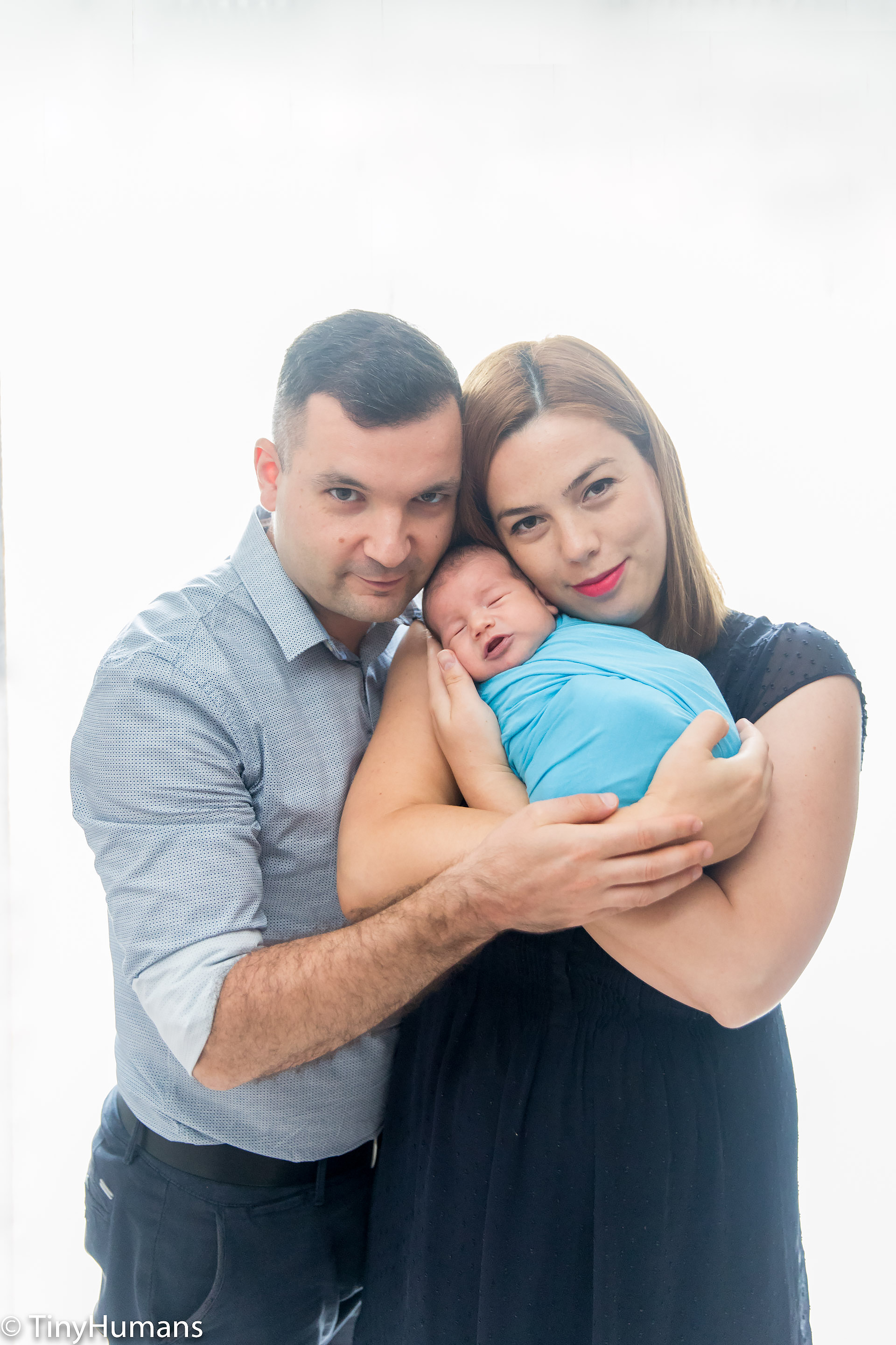 Parents with newborn baby at photo session
