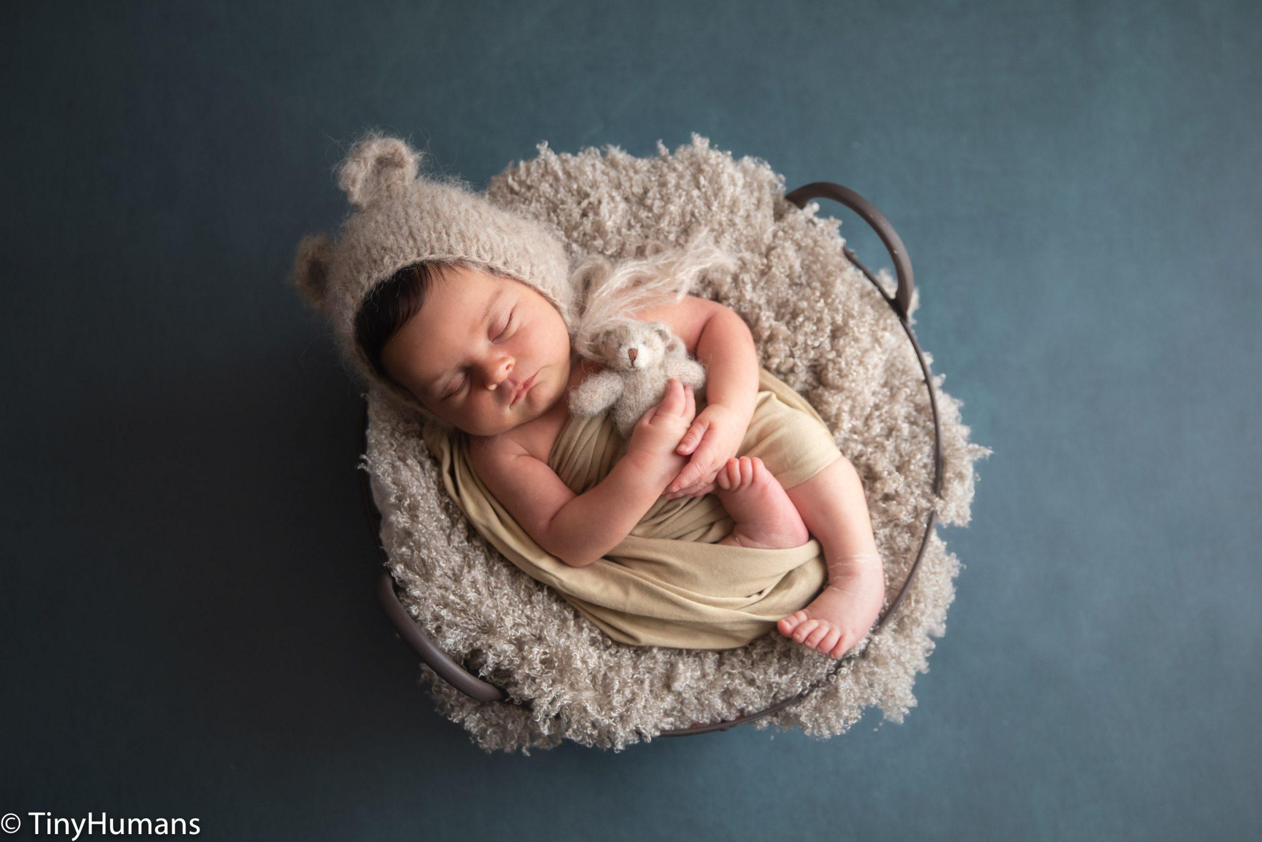 Sleeping newborn with teddy bear