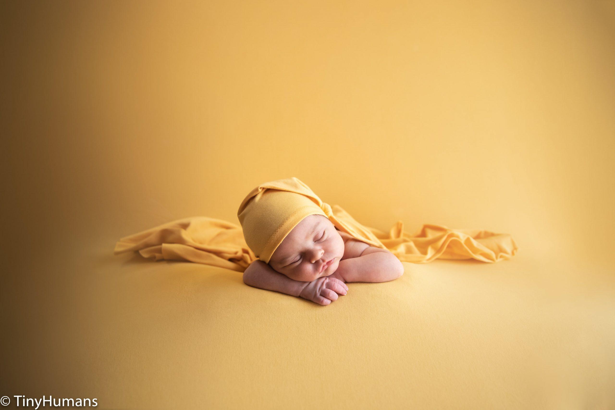 Newborn on yellow background